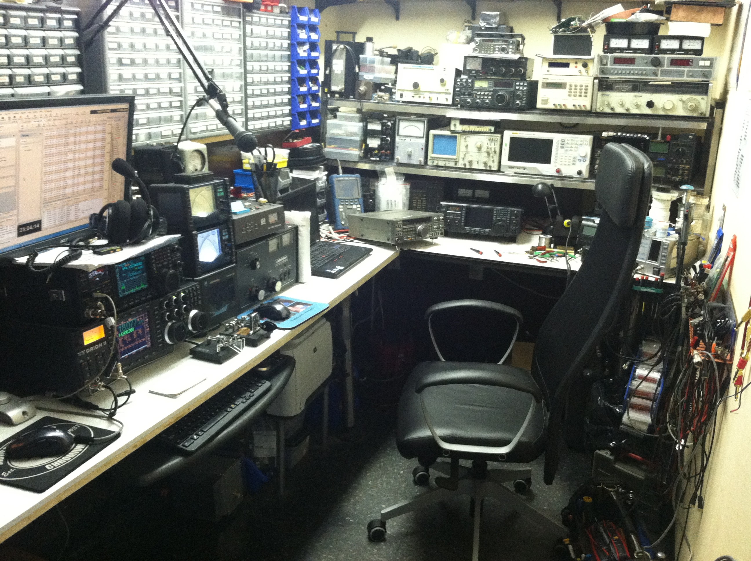 amateur radio electronic workbench  Bob's home station showingLeft to Right, showing thehome brewed 803 pentode 200 watt input Amplifier, Log Book on table, Meissner Signal Shifter with single ...